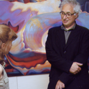Renowned painter and printmakerTerry Winters shown here with paula Crawford, views her thesis exhibit at RIT.